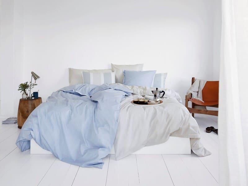 Stilvolles Bett mit Bettwäsche von Schlossberg Switzerland